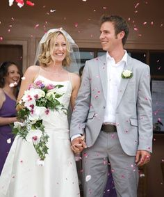 Let's talk about grooms - his casual suit is perfect for a more relaxed wedding, but he still looks smart in grey.
