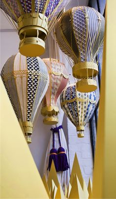Paper hot air balloons for window display, YCN London~by The Makerie Studio.