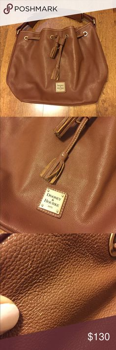 Dooney & Bourke Bucket Bag Beautiful chocolate brown shoulder bag! Soft and supple genuine leather. (Not AWL) This is very large - please note photos for exact measurements. There are a couple pin point scuffs that I've tried to show in photographs. This is the only wear! Otherwise this is spotless and in excellent condition! Dooney & Bourke Bags Shoulder Bags