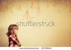 Hipster kid thinking. Idea concept. Drawing bulb lump. Retro toned - stock photo