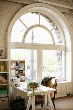 Beautiful Arched Window - what an office space.