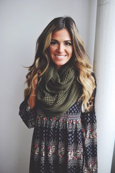 So adorable! Awesomely huge knit infinity scarf, and a cool boho patterned tunic.