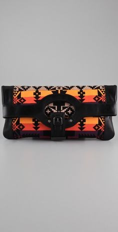 L.A.M.B. clutch which can also be unhooked into a tote. The pattern/color scheme is wonderful