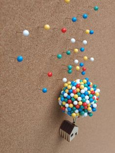 This fun new pin cushion by UK designer Clive Roddy promises to elevate your pushpin storage in a manner reminiscent of the Pixar film Up. The tiny wooden house with a large cork sphere can sit on … Disney Diy, Disney Home Decor, Disney Crafts, Plywood House, Balloon Clusters, Diy And Crafts, Arts And Crafts, Disney Rooms, The Balloon