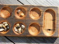 want: Handcrafted driftwood Mancala game board