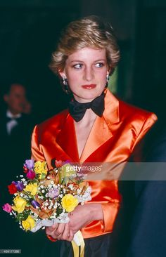 Diana, Princess of Wales wears an Orange Jacket, and Bow Tie, at a evening event, during an official visit to Lisbon, Portugal. on February 12 1987, in Lisbon, Portugal.