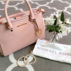 """Michael Kors Small Sutton Saffiano Leather Satchel PRICE IS FIRM Michael Kors Small Sutton Saffiano Leather Satchel. This is such a great neutral color!   Color: pastel pink  -Saffiano Leather  -3"""" Handle Drop  -18-20"""" Adjustable Strap  -Interior Details: Two Top Zip Pockets One Interior Zip Pocket Three Open Pockets One Cell Phone Pocket One Key Fob  -8"""" X 6"""" X 3.75""""  -Magnetic Closure Michael Kors Bags Satchels"""