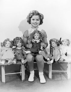 Shirley Temple with her Shirley Dolls