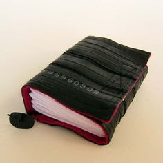 Recycled journal, bike inner tube, blank pages, pink linen and black velcro closure, small.