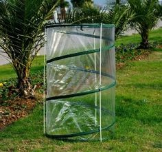 """Outsunny Pop-Up Mini Greenhouse / Plant Cover - 2 PACK by Outsunny. $23.97. Great for: Small patio trees (Palm, Ficus, etc), Tomato plants, with or without Tomato cage, small citrus trees, etc. Includes TWO full mini pop-up greenhouses. 43"""" tall and 27 1/2"""" diameter. Provides your outdoor plants Fall, Winter and early Spring protection from adverse weather conditions. Outsunny's durable, lightweight pop-up mini-greenhouses offer protection from frost, snow, ice,..."""