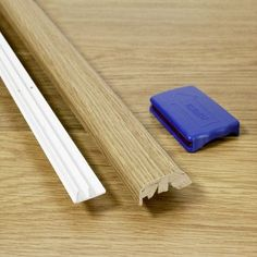 """Quick-Step 0.69"""" x 2"""" x 84"""" Multifunctional Molding in Sunset Oak"""