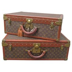 Pair of Louis Vuitton Alzer Vintage Suitcases | From a unique collection of antique and modern trunks and luggage at http://www.1stdibs.com/furniture/more-furniture-collectibles/trunks-luggage/