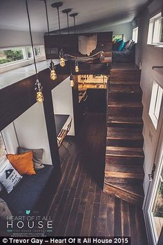 All they need: An architect worked with the small space to fit a bed, storage cupboards, a...