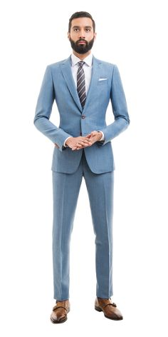 When your light blue linen suit reflects the blue skies of spring and summer, things start looking up. Keep things upbeat with crisp white shirts and balance things out with a darker tie and brown loafers or lace-ups. Mens Light Blue Suit, Baby Blue Suit, Blue Linen Suit, Khaki Suits, Black Suits, Mens Fashion Suits, Mens Suits, Suit Combinations, Suit Shirts
