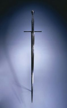 Hand-and-a-Half Sword, c. 1550 Germany, mid-16th century steel, blued pommel and quillions, leather grip, Overall: l. 123.90 cm (48 3/4 inches); Blade: l. 92.30 cm (36 5/16 inches); Quillions: w. 24.80 cm (9 3/4 inches); Grip: w. 30.50 cm (12 inches). Gift of Mr. and Mrs. John L. Severance 1916.1506