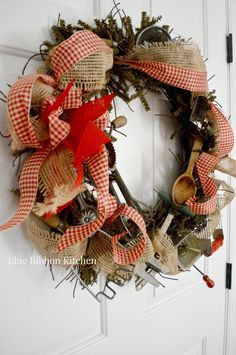How to Make a Vintage Kitchen Tool Wreath - using a wreath base, kitchen utensils and burlap - via Blue Ribbon Kitchen