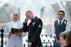 This groom can't help shedding a tear as his bride walks down the aisle.