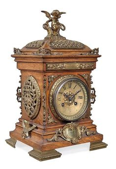 Lot: A French gilt brass mounted oak mantel clock retailed, Lot Number: Starting Bid: Auctioneer: Dreweatts Donnington Priory, Auction: Interiors, Date: August 2013 GMT Oak Mantel, Mantel Clocks, Unusual Clocks, Cool Clocks, French Clock, Classic Clocks, Retro Clock, Antique Clocks, Vintage Clocks