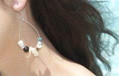 item #E024-S9B Mermaid's treasure hoops- are made with the most amazing selection of mother of pearl, turquoise, brown and teal rondelle stones, spiral shells, oahu seashells & oahu pukas set on sterling silver hoops. (measuring 3 in by 1 in)