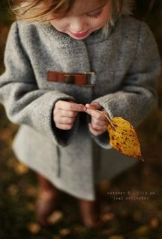 beautiful gray texture in jacket balanced with yellow leaf
