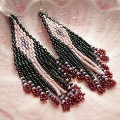 Mexican style Guadalajara fringe earrings in Peach, Black and Red. Intricate, dainty and super fun, these earrings dance as you move. Paired with a black off-the-shoulder blouse = bonita señorita!  They are made using sterling silver earring hooks and tiny Japanese glass seed beads, which I have woven together one at a time. They measure 62mm from tip to top.  These are made to order. Please contact me for current turn around time and custom requests.   Read my shop policies here…