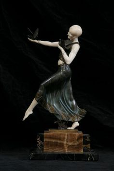 Patinated bronze and ivory sculpture depicting Dancer with Colombe.Firma: Jean Lormier.    Made in FranciaCirca 1925