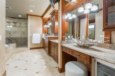 Craftsman style bathroom with makeup counter and vessel sinks