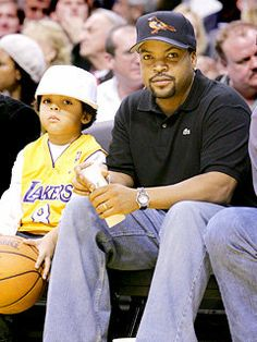 Ice Cube and son O'Shea Jackson Jr. attend the game between the Los Angeles Lakers and the Dallas Mavericks at the Staples Center in Los Angeles, California.