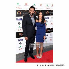 Nysa Devgn in a customized #ShivanAndNarresh Midnight Blue Off-shoulder Dress at London Indian Film Festival, with her father Ajay Devgn   #Fashionable #Fashion #Style #Trend #Sophistication #Designer #Stylish #FashionStyle #DressUp #Collection #Outfit #Girl #Glam #Chic #NysaDevgn #AjayDevgn