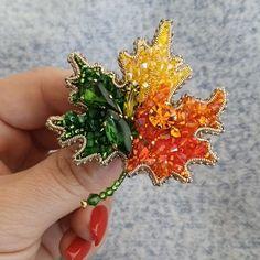 """Kristiina (Estonia:-)🇪🇪 on Instagram: """"Забронирован. И еще один яркий кленовый листик :) в нем кристаллы и бусины Сваровски и два винтажных зеленых кристалла Preciosa :)…"""" Photo And Video, Beads, Crystals, Brooches, Rings, Floral, Flowers, Jewelry, Instagram"""