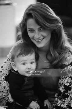English actress Charlotte Rampling with her 8 month-old baby son Barnaby, at Heathrow Airport, London, 11th May 1973. Rampling, her son and her husband Bryan Southcombe are on their way to Dublin, where Rampling is to begin rehearsals for the film 'Zardoz', directed by John Boorman.