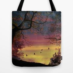 Catch of the day Tote Bag ABOUT THE ART Some birds flying in the beautiful morning sky. Seen through some trees in the forest.  Nature, birds, silhouettes, flight...