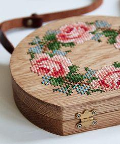 Embroidered wooden bag by GRAV GRAV.