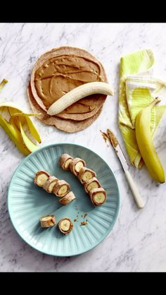Brown rice tortilla with organic peanut butter or almond butter and banana.
