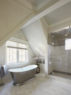 """The bathroom was designed to maximize storage, with space under the vanity, in a small cabinet by the tub, and in another floor-to-ceiling cabinet (not shown). """"The idea was that you shouldn't have to leave the bathroom for a towel or anything else you might need,"""" says Chambers."""