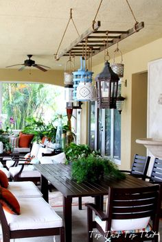 Ladder and Lantern Patio Lighting. Very interesting. love the ladder for hanging lights