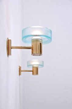Anonymous; Brass and Glass Wall Lights by Seguso, 1960s.
