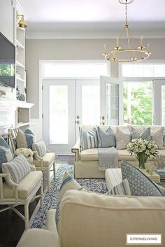 Gorgeous living room with white sofas blue and white striped pillows and layered textures for an airy summer coastal chic look. Gorgeous living room with white sofas blue and white striped pillows and layered textures for an airy summer coastal chic look. Coastal Living Rooms, Home Living Room, Living Room Designs, Living Room Decor, Blue And White Living Room, Blue And White Pillows, Muebles Living, Living Room Seating, Dining Room