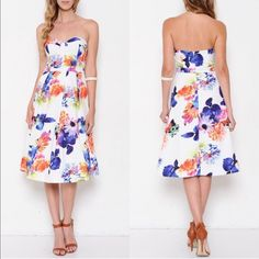 The AZALEA floral strapless dress - WHITE HPx5A DROP DEAD GORGEOUS floral dress featuring a strapless bodice. Zipper back closure. A-line silhouette. Finished hem. Super sophisticated & what a fun pop of color. NO TRADE, PRICE FIRM Dresses Strapless