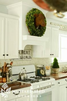A Range Hood, A Cow Head & Angel Wings - Miss Mustard Seed. Love the green with white kitchen colors. Kitchen Redo, Kitchen Dining, Kitchen Ideas, Kitchen Cabinets, Kitchen Stove, Kitchen Makeovers, Diy Cabinets, Kitchen Designs, Custom Kitchens