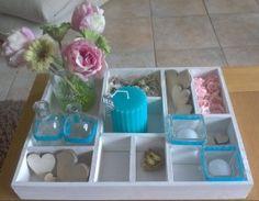Letterbak,bloemetjs, kaars,vaasjes en houten hartjes bij de action gehaald .Voorjaar een beetje in huis.
