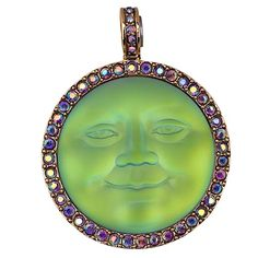 Seaview Moon Magnetic Interchangeable Enhancer Pendant in Sphinx She is absolutely glowing!http://kirksfollystore.com/magnetic-enhancers/seaview-moon-magnetic-enhancer-goldtone/green-sphinx/