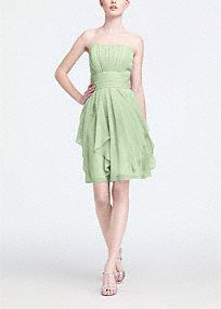 A simple silhouette gets a modern update for a look that is ultra feminine.  Flowing chiffon cascades from the waist to shape loose, romantic layers.  Pleated bodice adds dimension and flatters all figures.  Soft chiffon moves with the body to create a mesmorizing overall look.  Fully lined. Back zip. Imported polyester. Dry clean only.  Available in our exclusive 40 color palette.  Available in sizes 2-30 in stores.  Get inspired by our colors.