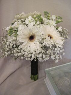 The finished bridal bouquet of baby's breath, gillyflower and gerbera daisies for this lovely September wedding. Congratulations to Helena and her groom! Floral design by Middletown Florist & Gifts (www.mtownflorist.com)