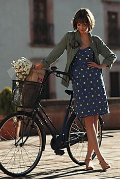 Cute girl standing next to her bicycle with a bouquet of flowers in a basket, Italy Check out Bicycles of Italy story by Patty Mooney at http://sandiegovideoproduction.com/bicycles-of-italy/