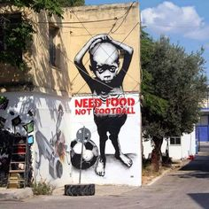 Street Art Brazil WorldCup - Need Food Not Football, artist unknown