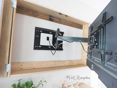 Free plans for a DIY wall mounted tv cabinet. Build a cabinet to hide the flat screen TV behind art in your home. Simple instructions for hidden tv cabinet. Tv Cabinet Design, Tv Wall Design, Tv Wall Cabinets, Diy Cabinets, Diy Wand, Hidden Tv Mount, Hidden Tv Cabinet, Wall Mount Tv Cabinet, Diy Tv Wall Mount