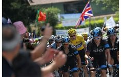 Overall leader's yellow jersey Britain's Christopher Froome (C) rides with his teammates during the 191 km fourteenth stage of the 100th edition of the Tour de France cycling race on July 13, 2013 between Saint-Pourcain-sur-Sioule and Lyon, central eastern France. Photograph by: JOEL SAGET, AFP/Getty Images
