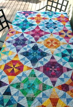 Kalidescope quilt by Juicy Bits, based on a kaleidoscope pattern from the book Noodle Soup. These saturated  colors are amazing.
