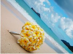 yellow plumaria bouquet. Maybe add some blue and purple and then it will be great. Awesome for bridesmaids